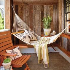 The perfect place to doze on a summer afternoon. String up a rope hammock on your porch. Use galvanized threaded eyebolts to secure it to wall studs, and leave room to sway. | Photo: Van Chaplin