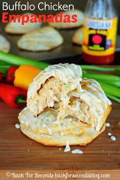 Easy Buffalo Chicken Empanandas - These are awesome and make a perfect easy dinner or snack for game day!  http://backforsecondsblog.com  #snack #easydinner #buffalochicken #cheese