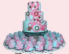Surround a larger cake with colorful cupcakes!