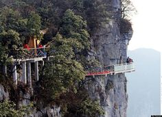 Terrifying Glass Skywalk on the Side of Tianmen Mountain, Hunan Province, China. Cliff is 1,430 meters high!