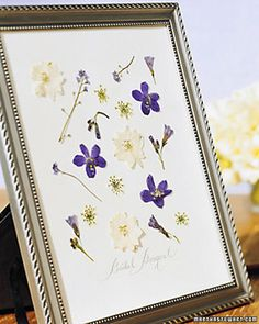 Traditionally, a bride selects a few flowers from her bouquet to press and put in the back of the wedding album. But there is no need for the blossoms to remain hidden away when they can easily be framed for display.