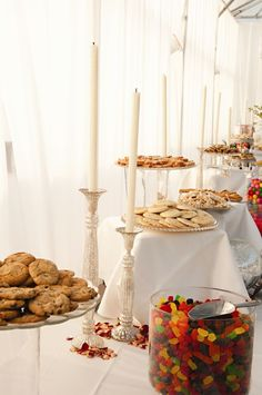 White candles on dessert table