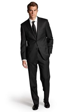Simple classic 2 piece black suit, white shirt and black tie, yes boring for some but an easy clean got it together  look without the effort of guessing. Suit Hugo Boss, yes they make great suits, if Hugo Boss is not in your budget an off the rack suit within your price range will look just as good if not better. Always recommend taking your off the rack to a tailor to get it tucked to fit you perfectly. Doing this will definitely make you look GQ.    #loledeux