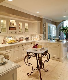Elegant kitchen with wrought iron and marble island. cabinets, french farmhouse, traditional kitchens, kitchen design, islands, farmhouse kitchens, french country kitchens, french kitchens, traditional homes