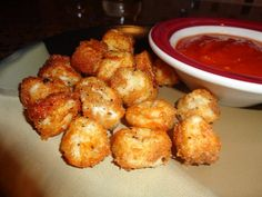 Baked Cheese Balls ~ Gotta try this...string cheese chopped into bite size pieces, dipped in milk and bread crumbs, baked at 425 for 8-10 minutes - serve with marinara sauce! It's baked not fried! Yum!