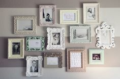 Love the striped wall and the mis-match frames!
