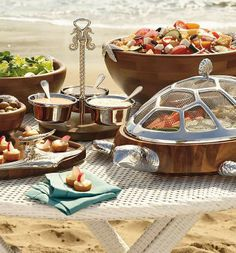 Icons of the ocean imbue our exclusive Ocean Luxe Serveware Collection with maritime flair.