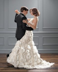 Ambiance~Distinctive Weddings and Events A Wedding Dress with Feathers and Sparkle Gown by : Selia Yang  c/o marthastewartweddings   For Planning Help Call  (410) 819-0046  MaryannJudy.com