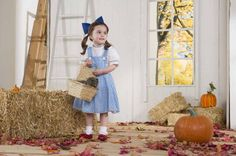 12 Halloween Costumes That Morph to Year-Round Dress-Up | Working Mother:  Dorothy + Toto + Ruby Slippers.  Dorothy Gale—and her little dog, too—is a popular dress-up character for the fourth year running. Growing girls get to look pretty, but not baby-ish, in this blue gingham jumper. And of course, she'll want to tie the whole ensemble together with ruby slippers! (costume $35, toto in basket $17, ruby slippers $30, onestepahead.com)