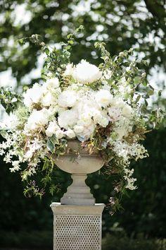 urn of white roses