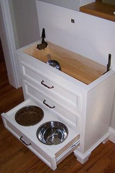 Pet Station ❤ Transform a small dresser. Keep food on top w/scoop.  Drawers hold records, meds, supplies, leash etc