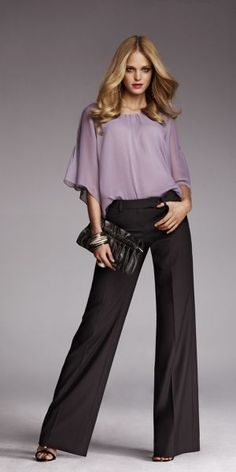 a soft lavender blouse adds a feminine touch to boyish trousers