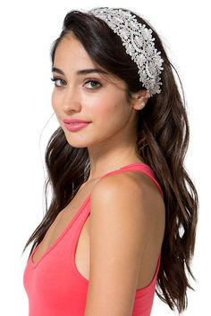 An adorable stretch headband featuring a champagne-colored crochet front in a daisy motif. Double bungee strap back.