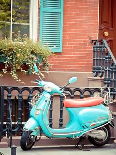 turquoise and orange vespa