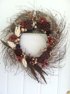 My fall time wreath! Lotus pods and poppy pods with some dried flowers and some craft store goodies