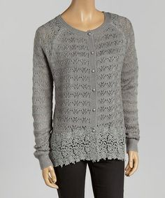 This classic cardigan silhouette gets a fabulous makeover in a chic knit and pretty lace, with a little bit of mohair bringing softness and texture to the mix.