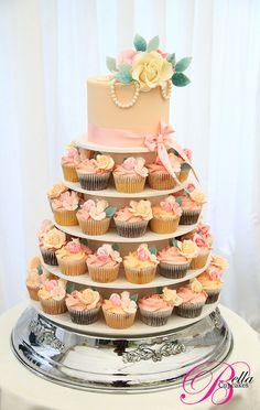 Peachy vintage wedding cupcake tower traditional weddings, vintage weddings, pearls, wedding cupcakes, cupcak tower, bella cupcak, wedding cakes, cupcake cakes, cupcake towers