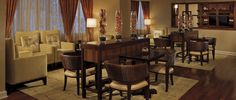 Unwind in The Ritz-Carlton Club® Level Lounge after an important, yet relaxed, business meeting at The Ritz-Carlton, Atlanta.