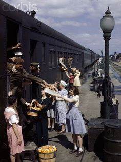Farm women give gifts of food to service men traveling by train at the North Platte Canteen in North Platte, Nebraska.