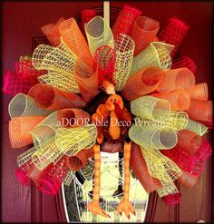 This unique wreath is decorated with five colors of mesh and an adorable plush turkey for the centerpiece. Deco mesh purchased at http://www.trendytree.com. For more of my designs please visit http://www.facebook.com/ADOORableDecoWreaths #trendytree #wreath