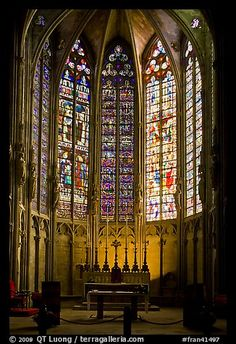 Altar and Stained glass windows at the Saint-Nazaire basilica in Carcassonne, France
