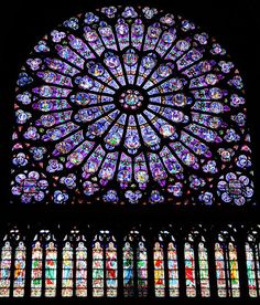 Notre Dame Cathedral. This rose window, the best known in the world, contains all the original glass from when it was created and installed, in 1220.