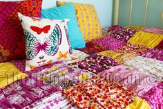 A gathered quilt/duvet. You gather the squares, put them on backing squares, then sew together. Isn't that darling?!