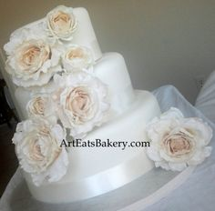 Art Eats Bakery 1626 East North Street, Greenville, SC 29607https://www.facebook.com/ArtEatsBakerySCThree tier ivory fondant modern unique wedding cake design with silk roses and ribbonsThe best custom designed unique #creative #modern birthday, baby shower and elegant romantic wedding cakes create a personal element to your party or reception that cannot be matched by decor or venue. It is the first thing your guests see at the party or reception and the last...
