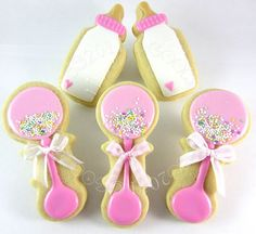 Baby shower cookies for girls. Like the sprinkles on the rattles.