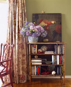 bennison drapery fabric, green wall paint w/ blue pottery accent and I love Victorian bamboo furniture.