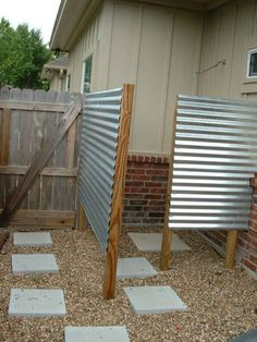 outdoor shower to rinse off. I like the galvanized tin, but maybe something else besides stepping stones.