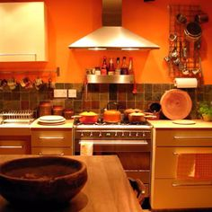 GREAT use of orange in this kitchen!  http://orangekitchendecor.siterubix.com/ #ppgorange