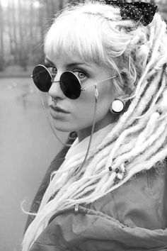 cool girl with septum and round sunglasses