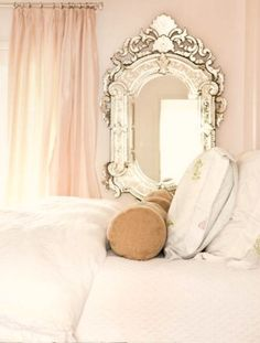 mirror next to the bed to balance window...