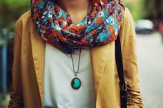 Yellow jacket, white shirt and colourful necklace