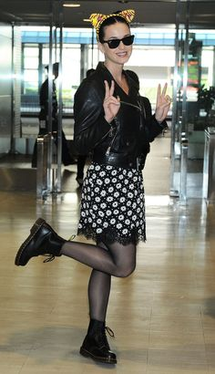 "Ready to ""Roar."" Katy Perry and her cat ears arrive at Narita International Airport on Oct. 30 in Japan"