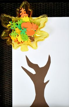 Practice fine motor skills and create some fall art with this simple fall tree invitation to create for kids.