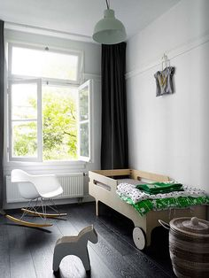 What a chic contemporary kids room. Love the mix of aesthetics and the pared down feel.
