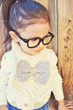 Who cares if it's for kids, I want one for me!  How To Knit A Bow Scarf » Little Inspiration