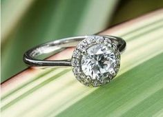 Simple band. All focus on the center. Perfect with an inexpensive simple wedding band. Breathtaking.