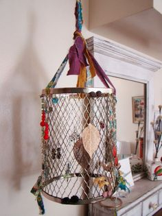 Hanging earring holder DIY...or you can use a small wire trash can and turn it upside down and hang it.....maybe spray paint it a pretty color if its not already.