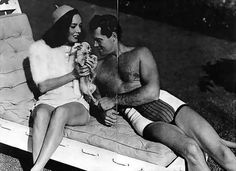 Lupe Velez getting cozy with Clayton Moore (The Lone Ranger)