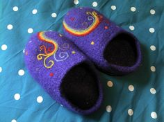 Hand knitted slippers, felted then needlefelted with rainbow design.