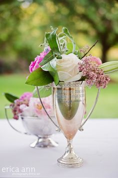 Vintage loving cup trophy for Kentucky Derby party décor...gorgeous, though I think that roses at a derby party should always be red
