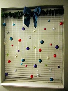 Tension Rod with Balls hanging on a window, for Christmas.