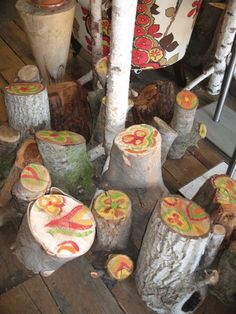Anthropologie - painted tree stumps  great idea for the Willow tree stump in my yard.  I'm sentimental & still love it.  This would be nice