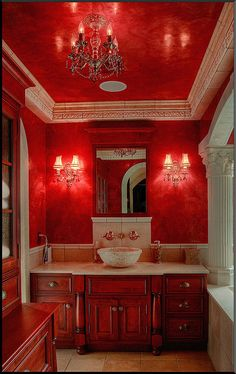 Red on the ceiling and walls of a bathroom.