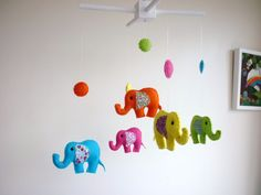 Rainbow Baby Elephants - Felt Nursery Mobile - Crib or Cot Mobile. $75.00, via Etsy.