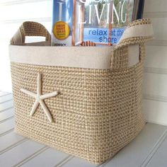 Sand colored fabric baskets adorned with sea stars.
