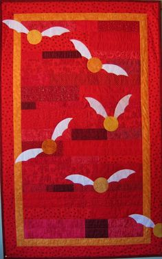Harry Potter Gryffindor Quilt by BadBabyQuilts on Etsy. Like those snitches! Need to get the pattern...
